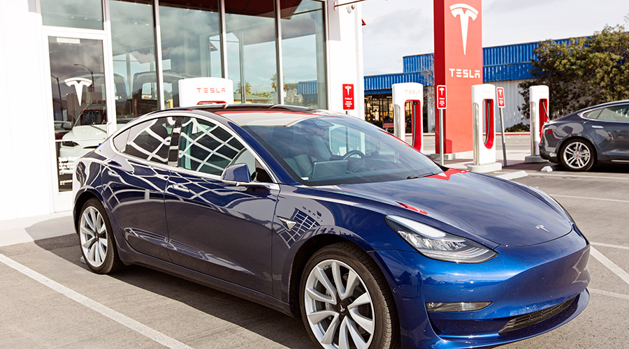 Tesla at the charging station, image source: Shutterstock