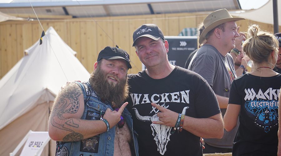 Heavy-Metal fans at the booth of The Mobility House at Wacken Open Air