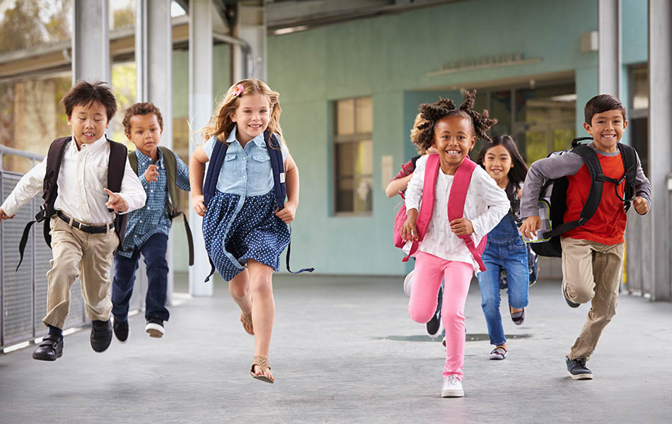 Children running in school