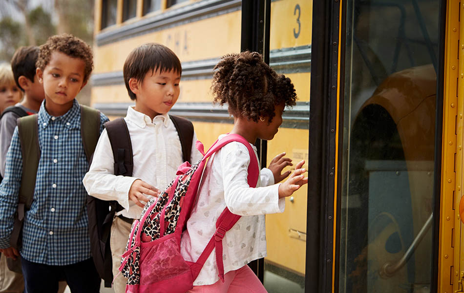 Children getting into school bus